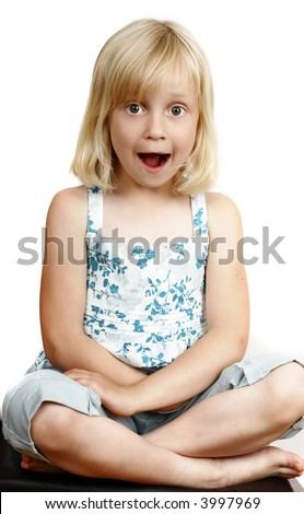 little girl making funny faces - stock photo