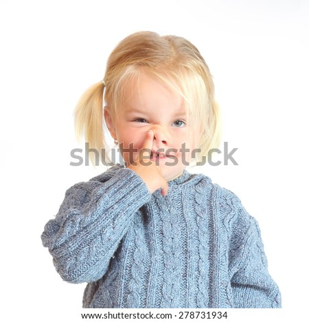 Little girl making grimace. Funny people on white background. - stock photo