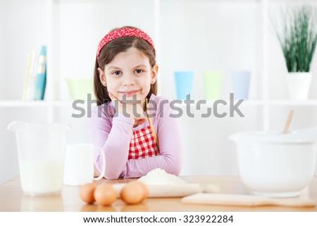 Little girl making the dough - stock photo