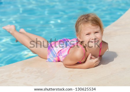 little girl near the swimming pool - stock photo