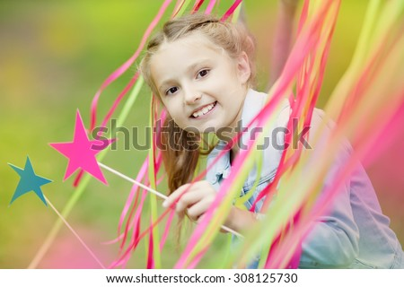 little girl on a children's holiday - stock photo