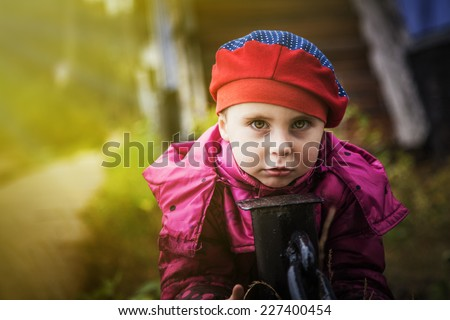 Little girl on a walk outdoors. - stock photo