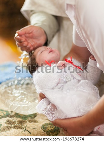 Little girl on ceremony of child christening in church - stock photo