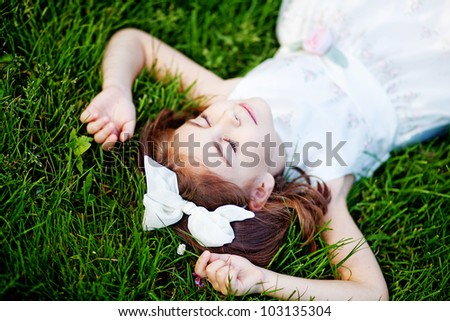 Little girl on grass - stock photo