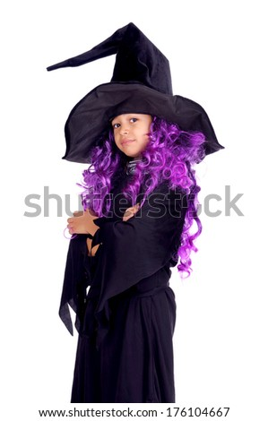 little girl on halloween with witch costume