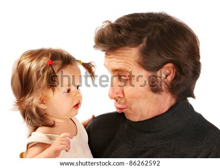 Little girl on hands at grandfather. - stock photo