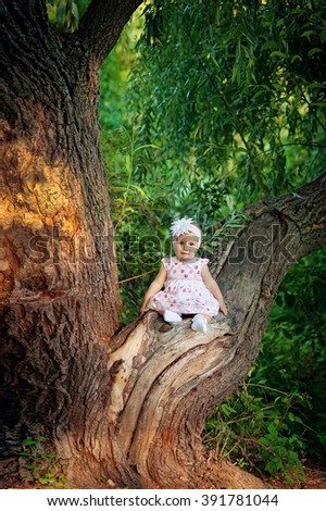 little girl on nature with a smile