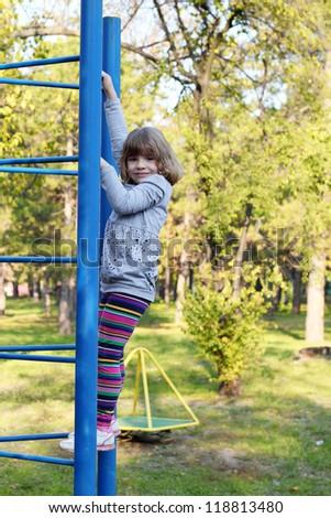little girl on park playground - stock photo