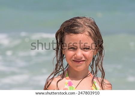 Little girl on the beach - stock photo