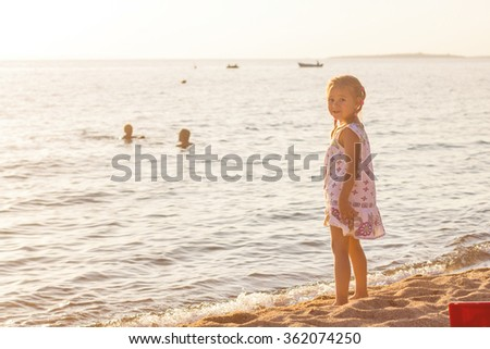 Little Girl  on the beach at the Aegean Sea.