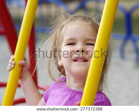 little girl on the playground.  - stock photo