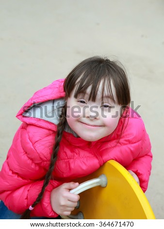 Little girl on the playground - stock photo