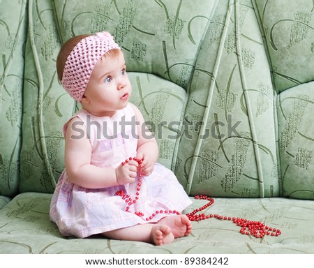 little girl on the sofa - stock photo