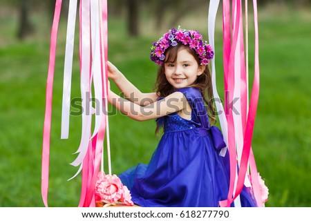 little girl on swing little girl stock photo 450079591 shutterstock