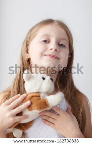 Little girl on windowsill with toy