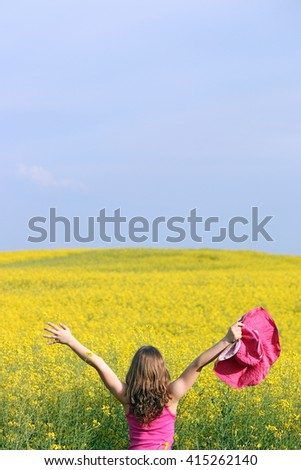 little girl on yellow field summer landscape - stock photo