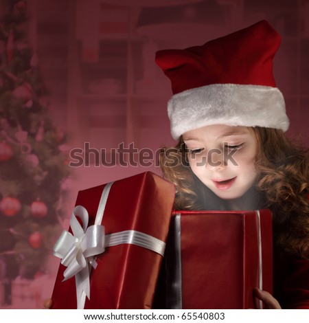 little girl open red gift box - stock photo
