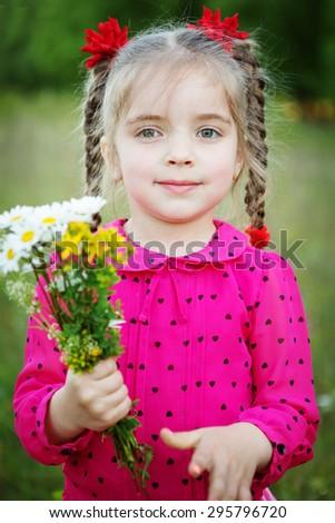 little girl outdoors - stock photo