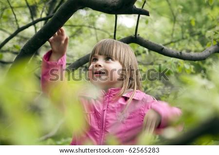 Little girl outdoors in park - stock photo