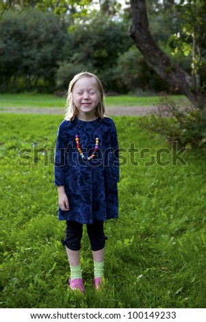 Little girl outdoors on a beautiful summer afternoon