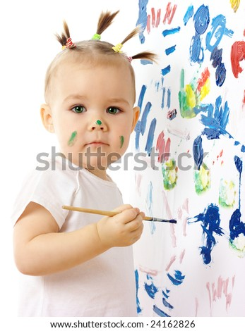 Little girl paint on a white board, isolated over white - stock photo