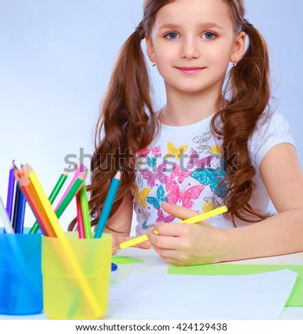 Little girl painting a picture, isolated on white background - stock photo