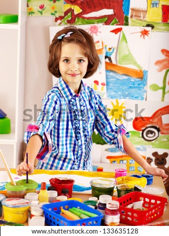 Little girl painting at  school. Education. - stock photo