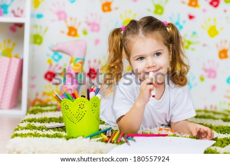 Little girl painting in her room at home  - stock photo