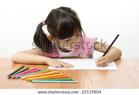 Little girl painting. Studio short - stock photo
