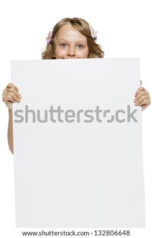Little girl peeking from the blank banner, over white background - stock photo