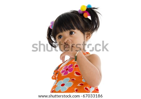 Little girl picking her nose, isolated on white background