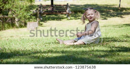 little girl play in the park