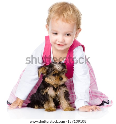 little girl playing and crawling with a puppy. isolated on white background - stock photo