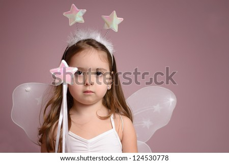 Little girl playing fairy - stock photo