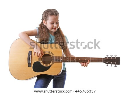 Little girl playing guitar, isolated on white