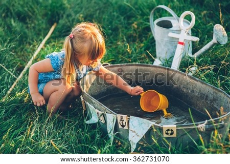 little girl playing in fishing - stock photo