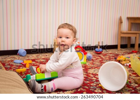 little girl playing in the children's room