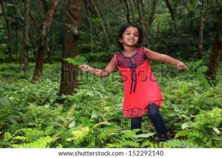 Little girl playing in the nature - stock photo