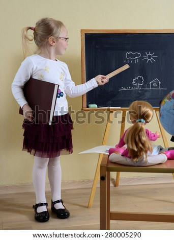 little girl playing in the school - stock photo