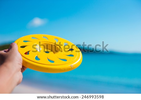 Little girl playing on a tropical white beach - stock photo