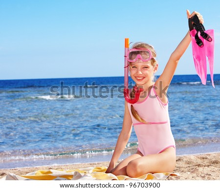 Little girl  playing on  beach. Summer outdoor. - stock photo