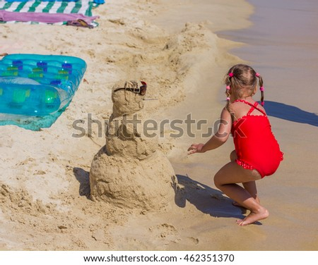 Little Girl Playing on sandy beach, Summer vacation.