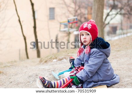 Little girl playing outdoor - stock photo