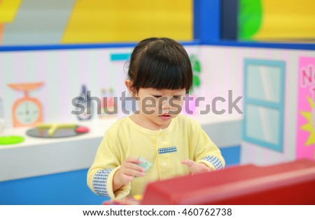 Little girl playing pretend as a sale in ice-cream shop