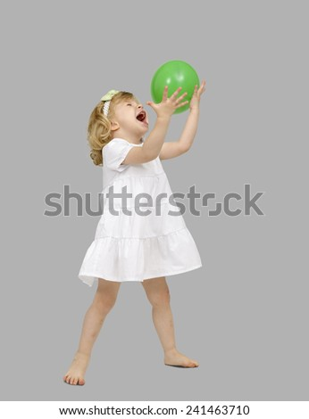 little girl playing with a balloon - stock photo