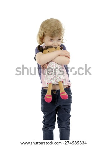 little girl playing with a doll, isolated on white