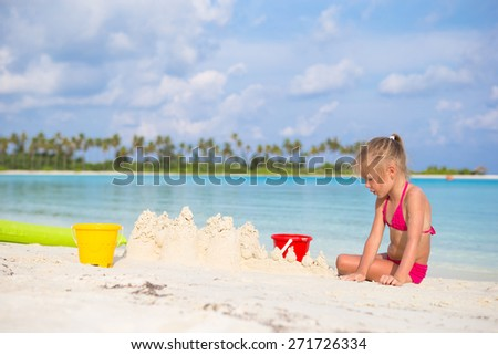 Little girl playing with beach toys on summer vacation