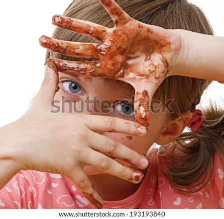 little girl playing with chocolate - stock photo