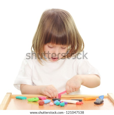 Little girl playing with clay isolated on white.