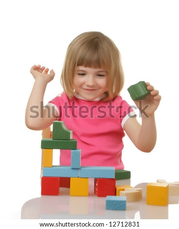 little girl playing with cubes - stock photo